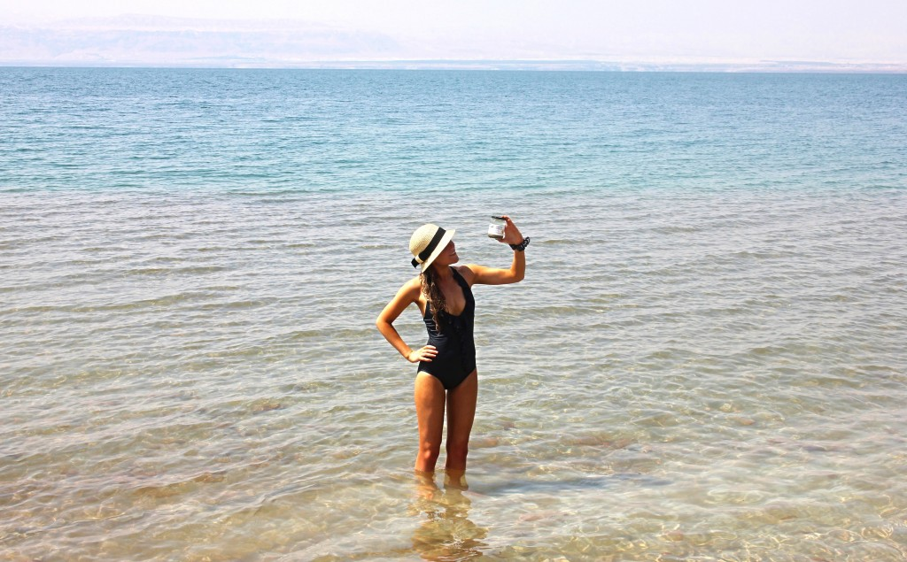 collecting salt water from the Dead Sea, Jordan, mud, floating in the dead sea