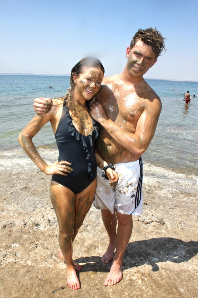 Floating in Dead Sea, Jordan. Covered in mud and natural sea salt from the Dead Sea