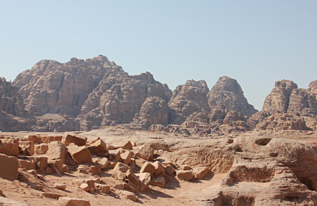 Surrounded by craggy conyons, rock formations Little Petra, desert, Jordan