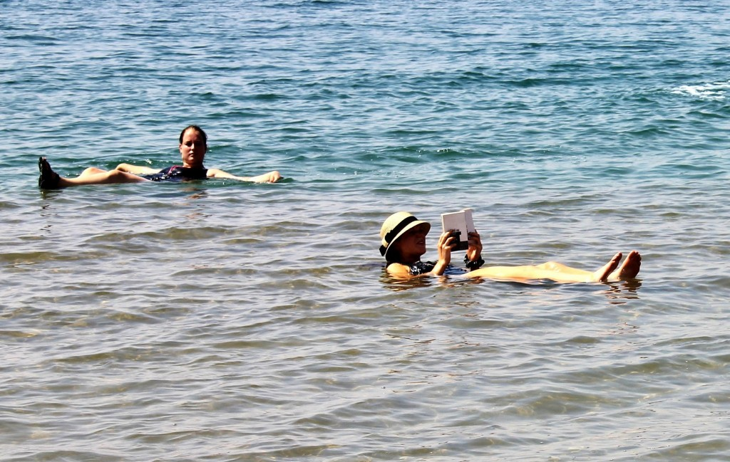 Floating and reading in the Dead Sea, Jordan.