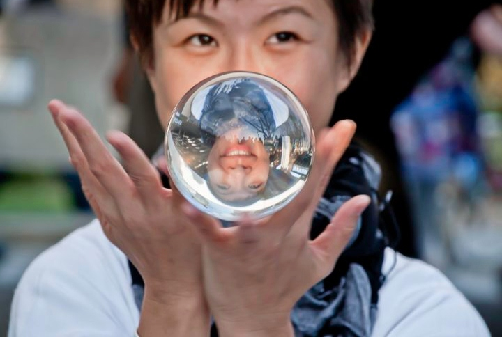 Contact juggler with crystal ball, street performer in London