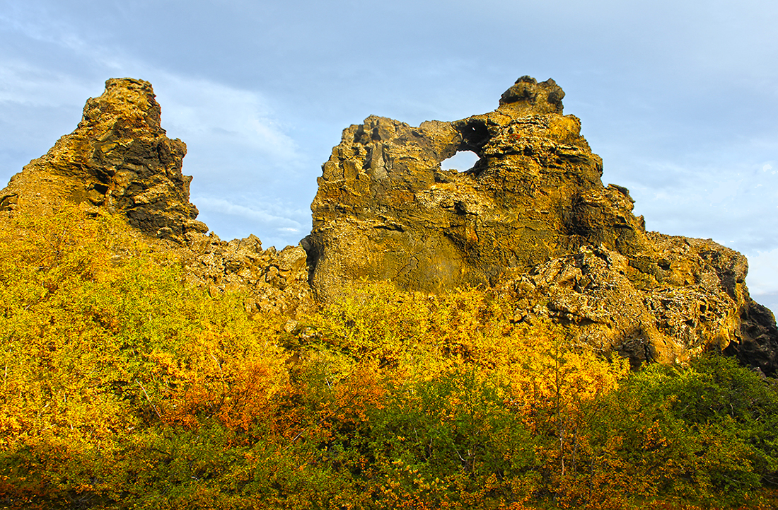 See the rock formations at Dimmuborgir in North Iceland