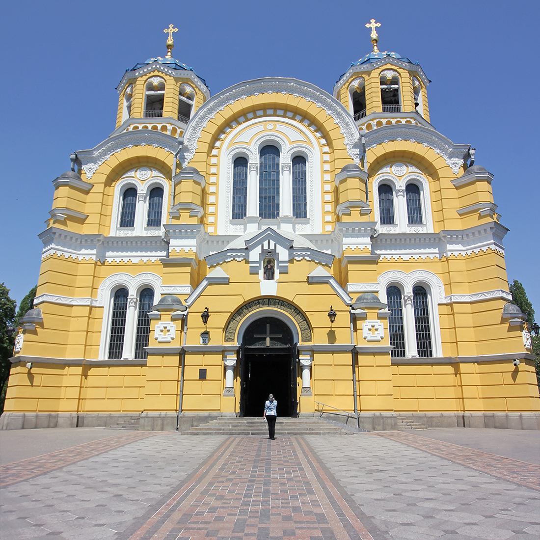 The bright yellow facade of Volodymr's Cathedral in Kyiv, Ukraine